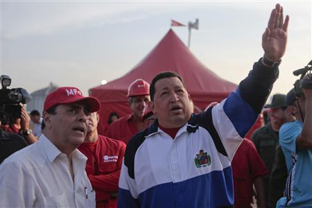 Venezuelan President Hugo Chavez (R) gestures during a visit to an industrial complex in the state of Anzoategui July 13, 2012. REUTERS/Miraflores Palace/Handout