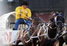 Chad Harden races his wagon in the Rangeland Derby Chuckwagon event during the 100th anniversary of the Calgary Stampede Rodeo in Calgary, Alberta July 13, 2012. REUTERS/Todd Korol