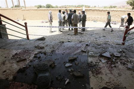 Afghan officials stand at the site of attack in Samangan province July 14, 2012. REUTERS/Stringer