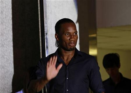Shanghai Shenhua's soccer player Didier Drogba from Ivory Coast attends a news conference in Shanghai, July 14, 2012. REUTERS/Aly Song