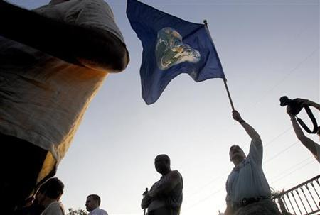Residents of New Orleans, along with members of the Sierra Club, a grassroots environmental organization, attend a ceremony to mark the one-year anniversary of the Deepwater Horizon tragedy, in New Orleans, Louisiana in this April 20, 2011 file photo. REUTERS/Sean Gardner