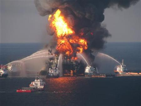 Fire boat response crews battle the blazing remnants of the offshore oil rig Deepwater Horizon, off Louisiana, in this handout photograph taken on April 21, 2010. REUTERS/U.S. Coast Guard/Handout