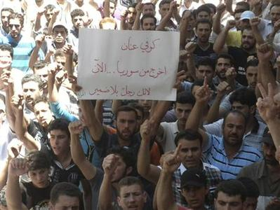 Demonstrators protest against Syria's President Bashar al-Assad after Friday Prayers in Houla near Homs July 13, 2012. Placard read,''Kofi Annan get out of Syria''. REUTERS/Shaam News Network/Handout