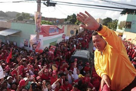 Venezuela's President Hugo Chavez (R) greets supporters during an election rally in Barquisimeto July 14, 2012. REUTERS/Miraflores Palace/Handout