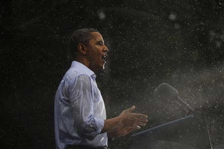 U.S. President Barack Obama speaks in the rain during a campaign rally in Glen Allen, Virginia, July 14, 2012. REUTERS/Jason Reed
