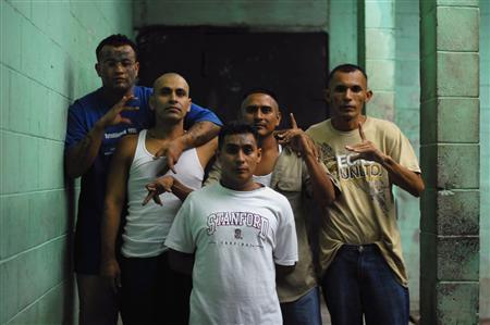 Gang members and inmates pose for a photograph at a prison in Quezaltepeque, on the outskirts of San Salvador June 2, 2012. REUTERS/Ulises Rodriguez