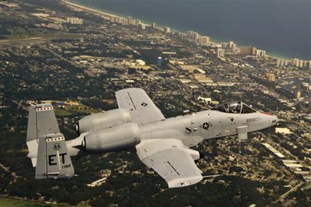 An A-10C Thunderbolt II flies over Florida's Gulf Coast on June 29, 2012, marking the second flight of an aircraft powered solely by an alcohol-derived jet fuel blend. Gevo Inc. recently sold the U.S. Air Force 11,000 gallons of fuel at $59 per gallon to complete certification testing to ensure it can be used in military jets. The company says it believes it can be cost-competitive with conventional fuel once it moves ahead with plans to build a commercial-scale production facility. REUTERS/Joely Santiago/U.S. Air Force/Handout