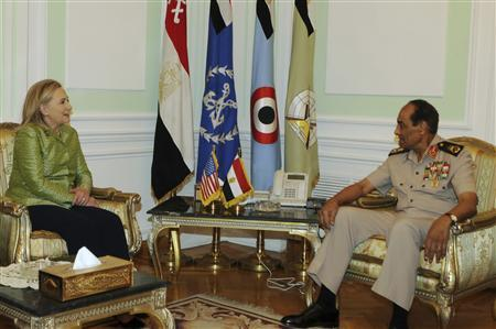 Egyptian military chief Field Marshal Mohamed Hussein Tantawi (R) meets with U.S. Secretary of State Hillary Clinton at the Defence Ministry in Cairo July 15, 2012. REUTERS/U.S Embassy Media Office/Handout