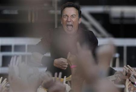 U.S. singer Bruce Springsteen performs with the E. Street Band during their European tour to promote their latest album ''Wrecking Ball'' in Frankfurt May 25, 2012. REUTERS/Alex Domanski