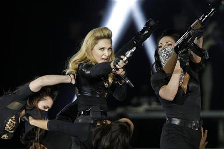 U.S. pop singer Madonna performs during a concert for her MDNA world tour at the Stade de France Stadium in Saint-Denis, near Paris, July 14, 2012. REUTERS/Benoit Tessier/Files