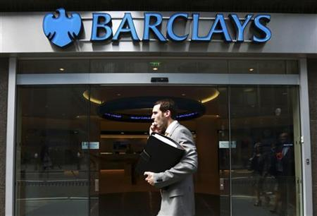 A man walks past a branch of Barclays Bank in the City of London, June 28, 2012. REUTERS/Olivia Harris/Files