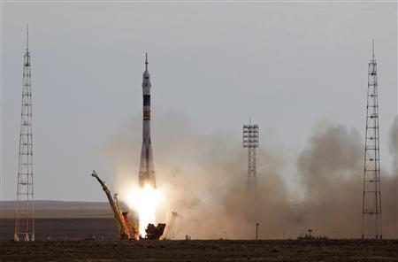 The Soyuz TMA-05M spacecraft carrying the International Space Station (ISS) crew of Russian cosmonaut Yuri Malenchenko, Japanese astronaut Akihiko Hoshide and U.S. astronaut Sunita Williams blasts off from its launch pad at Baikonur cosmodrome July 15, 2012. REUTERS/Shamil Zhumatov