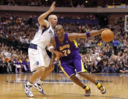 Los Angeles Lakers guard Kobe Bryant (R) drives past Dallas Mavericks guard Jason Kidd during the second half of their NBA basketball game in Dallas, Texas March 21, 2012. REUTERS/Mike Stone
