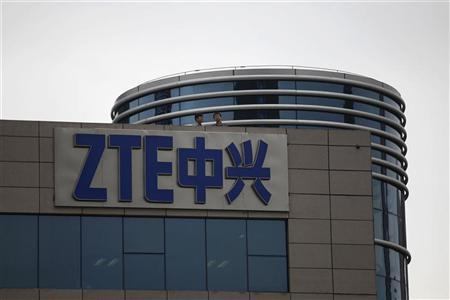 Employees of ZTE chat on the roof of its headquarters in Shenzhen, Guangdong province, April 17, 2012. REUTERS/Tyrone Siu