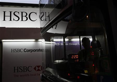 A bus drives past an advertisement of HSBC displaying outside its headquarters in Hong Kong September 7, 2011. REUTERS/Bobby Yip