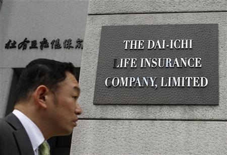 A man walks past the new signboard of Dai-Ichi Life Insurance Company Limited at its headquarters in Tokyo April 1, 2010. REUTERS/Issei Kato