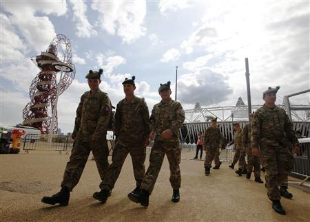 Members of the armed forces take a tour of the Olympic Park in Stratford, the location of the London 2012 Olympic Games, in east London July 15, 2012. REUTERS/Andrew Winning