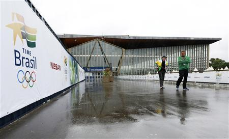 Brazilian sports staff walk outside the Crystal Palace National Sports Centre in south London, where the Brazilian Olympic team will be based during the London 2012 Olympic Games, July 16, 2012. REUTERS/Olivia Harris