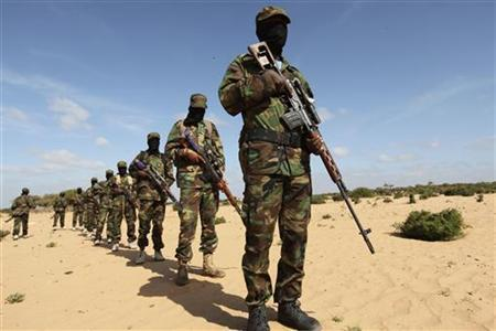 Members of Somalia's Al Shabaab militant group parade during a demonstration to announce their integration with al Qaeda, in Elasha, south of the capital Mogadishu February 13, 2012. REUTERS/Feisal Omar