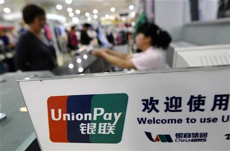 The logo of the China UnionPay is seen at a cashier at a shopping mall in Changzhi, Shanxi province June 3, 2010. REUTERS/Stringer