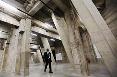 A worker walks through The Tanks, new galleries within the Tate Modern art gallery in London July 16, 2012. REUTERS/Luke MacGregor