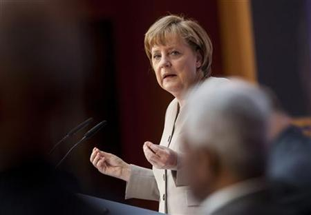 Germany's Chancellor Angela Merkel speaks at the Petersberg Climate Dialogue (Petersberger Klimadialog) in Berlin July 16, 2012. REUTERS/Thomas Peter