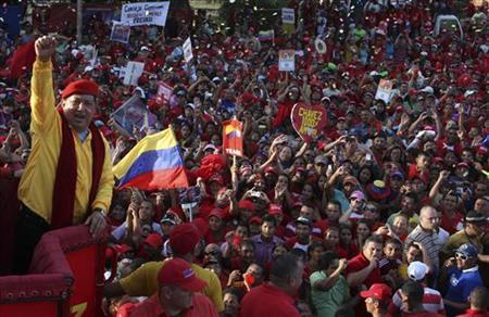 Venezuela's President Hugo Chavez (L) greets supporters during an election rally in Barquisimeto July 14, 2012. REUTERS/Miraflores Palace/Handout