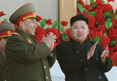 North Korean leader Kim Jong-Un (R) exchanges smiles with Ri Yong-ho during a military parade to mark the birth anniversary of the North's late leader Kim Jong-Il in Pyongyang, in this photo taken by Kyodo, February 16, 2012. REUTERS/Kyodo