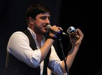 Marcus Mumford of British folk rock band Mumford and Sons performs at the Optimus Alive Festival in Alges, on the outskirts of Lisbon July 14, 2012. REUTERS/Hugo Correia