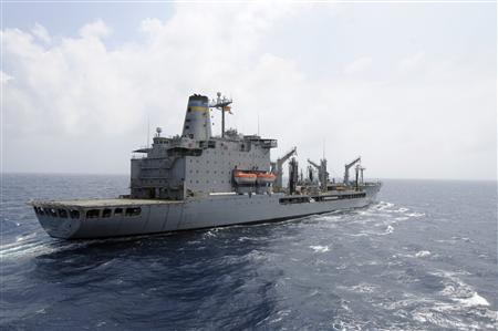 The U.S. Navy supply ship USNS Rappahannock maintains station as it prepares a replenishment at sea in this U.S. Navy photo handout photo taken in the South China Sea March 21, 2012. REUTERS/MC3 Cale Hatch/US Navy/Handout