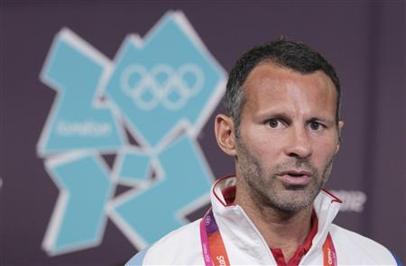Ryan Giggs, who will captain the British soccer team at the Olympic Games, speaks during a Team Great Britain soccer news conference at the Main Press Centre in the Olympic Park in Stratford, the location of the London 2012 Olympic Games, in east London July 16, 2012. REUTERS/Olivia Harris