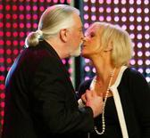 Former member of Swedish pop group 'ABBA' Anni-Frid Lyngstad (R) greets Jon Lord of 'Deep Purple' during the German media prize 'Die Goldene Henne' (The golden hen) award ceremony in Berlin September 22, 2004. REUTERS/Marcus Brandt/POOL