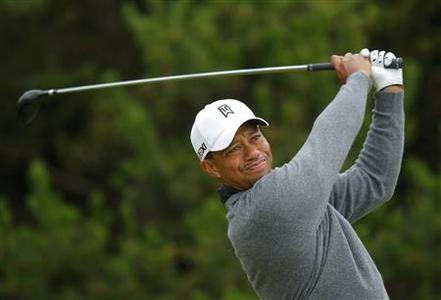 Tiger Woods of the U.S. watches his tee shot on the tenth hole during a practice round ahead of the British Open golf championship at Royal Lytham and St Annes, northern England July 16, 2012. REUTERS/Brian Snyder