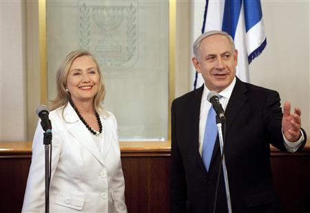 Israel's Prime Minister Benjamin Netanyahu (R) gestures during his meeting with U.S. Secretary of State Hillary Clinton in Jerusalem July 16, 2012. Clinton, arriving in Jerusalem from newly Islamist-controlled Egypt, told a wary Israel on Monday to treat the Arab Spring as an opportunity as well as a source of uncertainty convulsing the Middle East. REUTERS/Abir Sultan/Pool