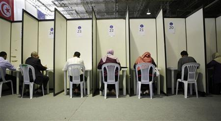 Ennahda party members fill up their ballot papers during the election of the new leadership of Ennahda in Tunis July 16, 2012. REUTERS/Zoubeir Souissi