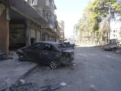Damaged vehicles and debris are seen in Karm Chmchm near Homs July 16, 2012. REUTERS/Shaam News Network/Handout