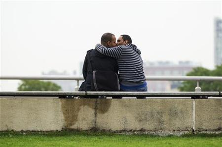 Two men kiss as they sit in a riverside park in New York, May 9, 2012. REUTERS/Lucas Jackson