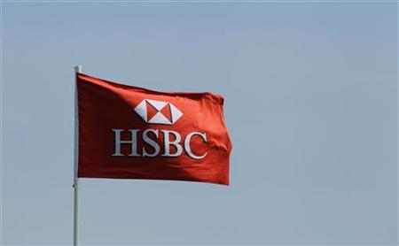 A HSBC flag flutters at Tanah Merah Country Club in Singapore February 24, 2012. REUTERS/Tim Chong