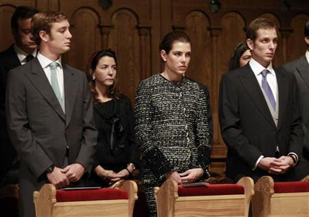 (L to R) Pierre, Charlotte and Andrea Casiraghi, children of Princess Caroline of Hanover, attend a mass in the Monaco cathedral for Monaco's National Day in Monte Carlo November 19, 2011. REUTERS/Eric Gaillard