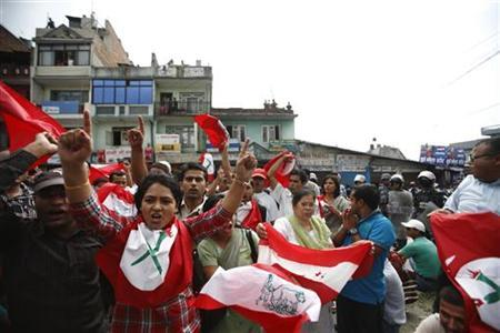 Cadres of the opposition party shout anti-government slogans in front of Tribhuvan International Airport, while waiting for Prime Minister Baburam Bhattarai's return from his trip to the Rio+20 summit held at Brazil, in Kathmandu June 25, 2012. REUTERS/Navesh Chitrakar