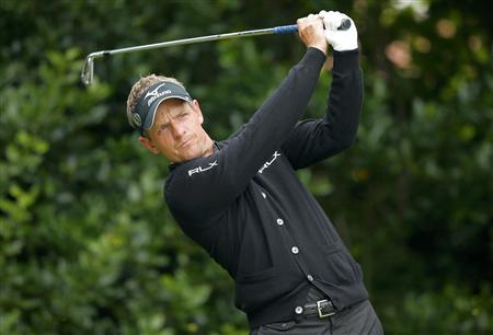 Luke Donald of England watches his tee shot on the first hole during a practice round ahead of the British Open golf championship at Royal Lytham and St Annes, northern England July 16, 2012. REUTERS/Brian Snyder