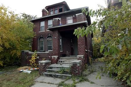 An abandoned and vandalized home listed on the auction block during the Wayne County tax foreclosures auction of almost 9,000 properties in Detroit, Michigan, is seen October 22, 2009. REUTERS/Rebecca Cook