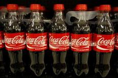 Bottles of Coca-Cola sit on a supermarket shelf in Gilbert, Arizona October 20, 2009. REUTERS/Joshua Lott
