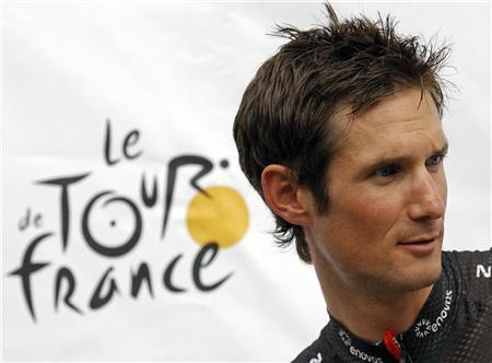 RadioShack-Nissan rider Frank Schleck of Luxembourg poses on the podium during the team presentation ahead of the start of the 99th Tour de France cycling race in Liege June 28, 2012. REUTERS/Stephane Mahe