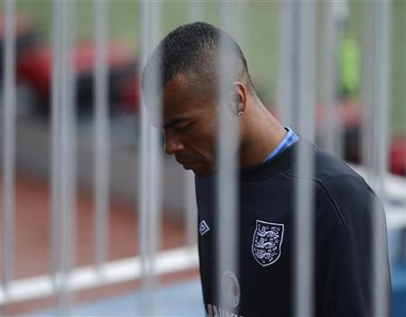 England soccer player Ashley Cole leaves early during a training session at the Hutnik stadium in Krakow June 13, 2012, ahead of their Euro 2012 soccer match against Sweden. REUTERS/Nigel Roddis