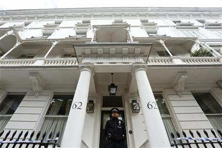 A policeman stands guard in front of the home of Eva Rausing in London July 11, 2012. REUTERS/Olivia Harris
