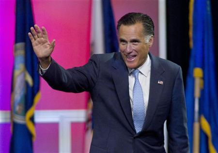 Republican presidential candidate Mitt Romney waves as he leaves the stage after speaking at the NAACP convention in Houston July 11, 2012. REUTERS/Richard Carson