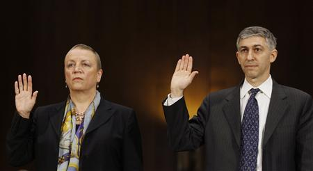 HSBC Bank President and Chief Executive Officer Irene Dorner (L) and HSBC Holdings Chief Legal Officer Stuart Levey are sworn in before testifying before the Senate Homeland Security and Governmental Affairs Committee in Washington July 17, 2012. REUTERS/Gary Cameron