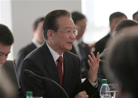 Chinese Premier Wen Jiabao speaks after signing agreements at the presidential house in Montevideo June 22, 2012. REUTERS/Pablo La Rosa