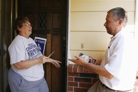 Gary Mason, a conservative candidate for Kansas' state Senate meets with voter Vicki Dick (L) in Wichita, Kansas, June 27, 2012. REUTERS/Nick Carey